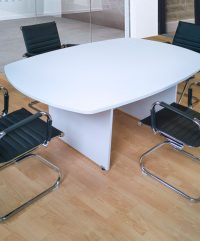 White boardroom table in office setting