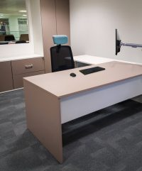 Executive radial workstation in office setting